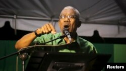 "FILE - Guyanan President David Granger, pictured in late 2014, is criticizing ""a persistence of aggressive behavior, hostile behavior towards Guyana"" on the part of Venezuela."