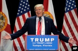 Republican presidential candidate Donald Trump gestures during a campaign speech in Tampa, Fla., June 11, 2016.