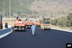 FILE - Road construction is underway as part of China's Belt and Road Initiative, in Haripur, Pakistan, Dec. 22, 2017.