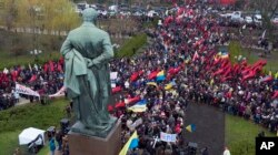 Supporters of former Georgian President Mikheil Saakashvili are gathering at the statue of Taras Shevchenko, a Ukrainian poet, writer, artist to march in protest of corruption in Ukraine in Kiev, Ukraine, Dec. 10, 2017.