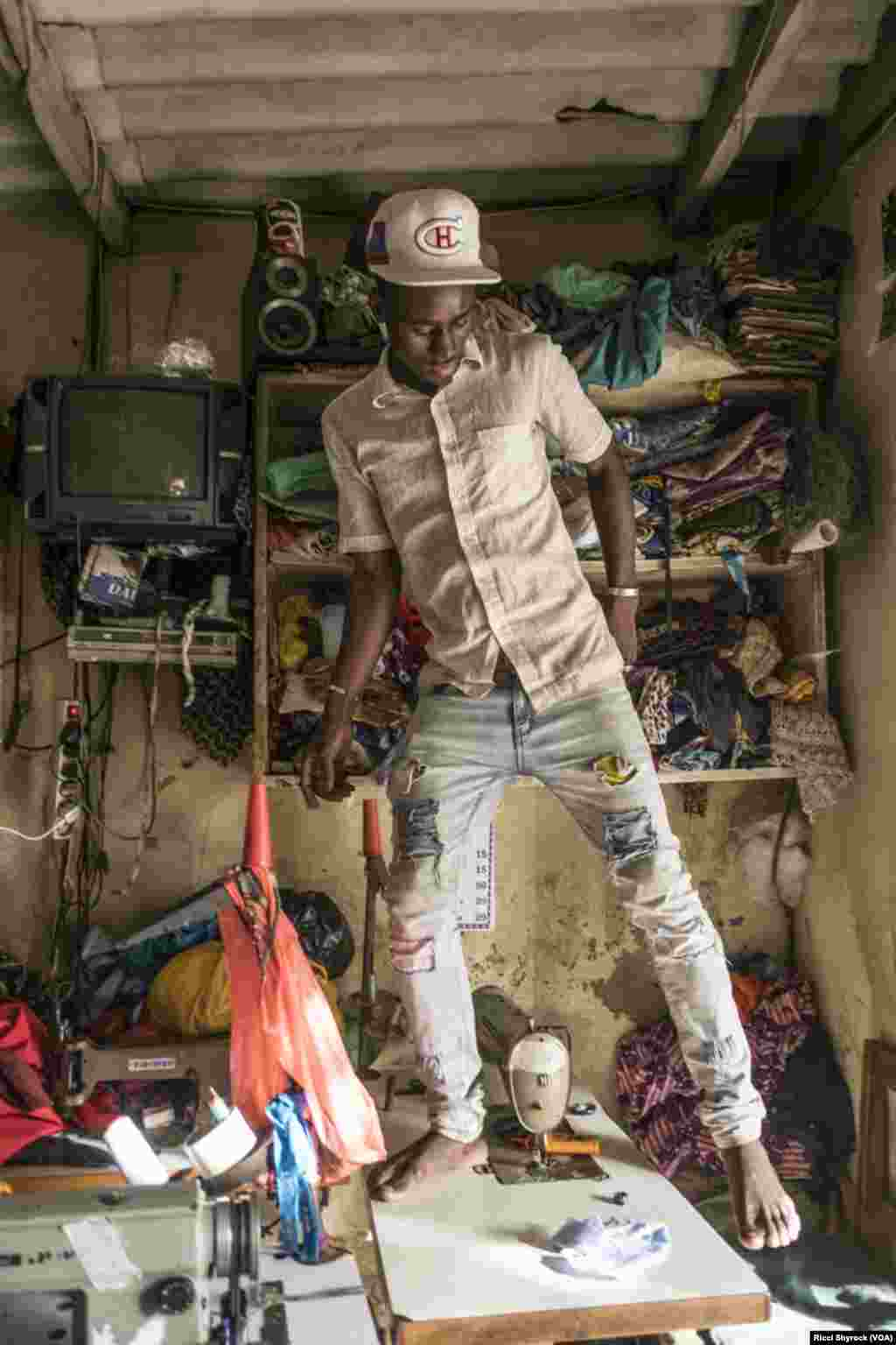 """A tailor works in Dakar's Niary Tally neighborhood, the working class area where Dakar Fashion Week held their """"Street Parade"""" fashion show this year, June 29, 2017. The show is free and takes place in an open and public area each year as part of Dakar Fashion Week's events."""
