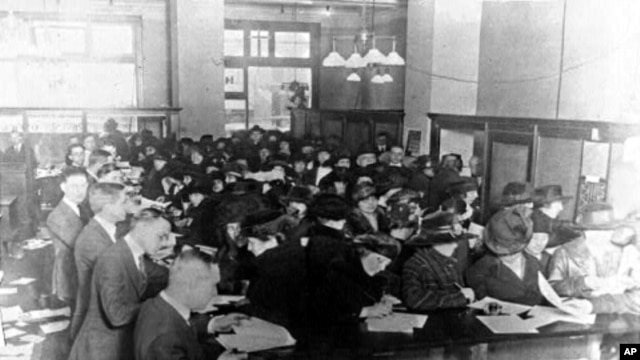 Americans fill out forms at an Internal Revenue Service office in 1920, seven years after the personal income tax was introduced.