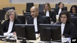 Representatives of the Office of the Prosecutor at the start of a two-day ICC hearing on where to try the eldest son of former Libyan dictator Moammar Gadhafi, The Hague, Oct. 9, 2012.