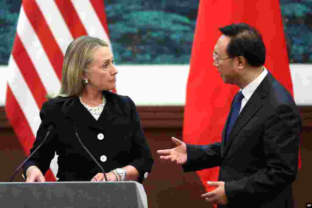 Chinese Foreign Minister Yang Jiechi, right, talks with U.S. Secretary of State Hillary Clinton after attending a press conference at the Great Hall of the People in Beijing, September 5, 2012.