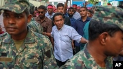 FILE - Maldivian President Abdullah Yameen Abdul Gayoom, center, surrounded by his body guards arrives to address his supporters in Male, Maldives, Feb. 3, 2018.