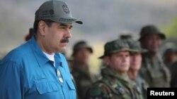 Venezuela's President Nicolas Maduro attends a military exercise in Turiamo, Venezuela, Feb. 3, 2019. (Miraflores Palace/Handout via Reuters)