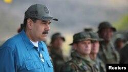 El presidente de Venezuela, Nicolás Maduro, asiste a un ejercicio militar en Turiamo, Venezuela, el 3 de febrero de 2019, donde dijo que participaré en otros del 10 al 15 de febrero.