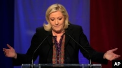 Far right National Front party leader Marine Le Pen delivers a speech after the announcement of partial results in the second round of regional elections, in Henin-Beaumont, northern France, Dec.13, 2015.