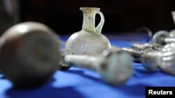 Some of the artifacts from more than 60 Iraqi cultural treasures illegally smuggled into the United States that were returned to the Republic of Iraq, are displayed on a table, the Department of Homeland Security said in Washington, March 16, 2015, as pictured in this undated handout photo provided by the U.S. Immigration and Customs Enforcement (ICE).
