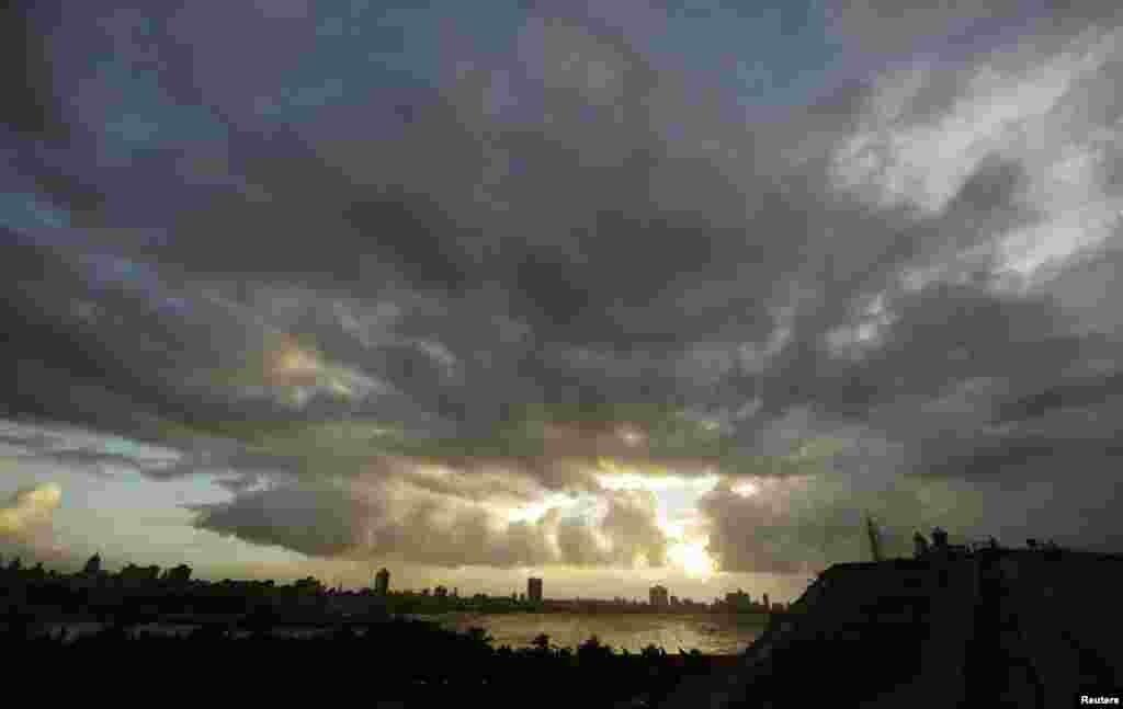 Storm clouds fill the sky over Havana, Cuba, October 24, 2012.