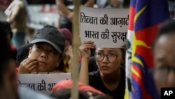 Exile Tibetans listen to a speaker during a protest to show support with India's Doklam standoff in New Delhi, India, Aug. 11, 2017.