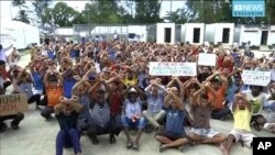 FILE - This photo made from Australia Broadcasting Corporation video taken Oct. 31, 2017, shows asylum-seekers protesting the possible closure of their detention center on Manus Island, Papua New Guinea.
