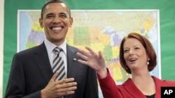 ປະທານາທິບໍດີໂອບາມາແຫ່ງສະຫະລັດ ແລະນາຍົກລັດຖະມົນຕີ Julia Gillard ແຫ່ງອອສເຕຣເລຍ. ວັນທີ 16 ພະຈິກ 2011.