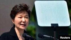 FILE - South Korean President Park Geun-hye delivers a speech.
