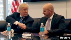 FILE - Donald Trump, Republican presidential nominee at the time, shakes hands with Brandon Judd, President of the National Border Patrol Council, while receiving the group's endorsement during a meeting at Trump Tower in New York, Oct. 7, 2016.