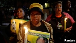 Well-wishers gather in support of ailing former South African President Nelson Mandela outside his former home in Soweto June 27, 2013.