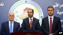 伊拉克新议会议长贾布里(中)和他的副手