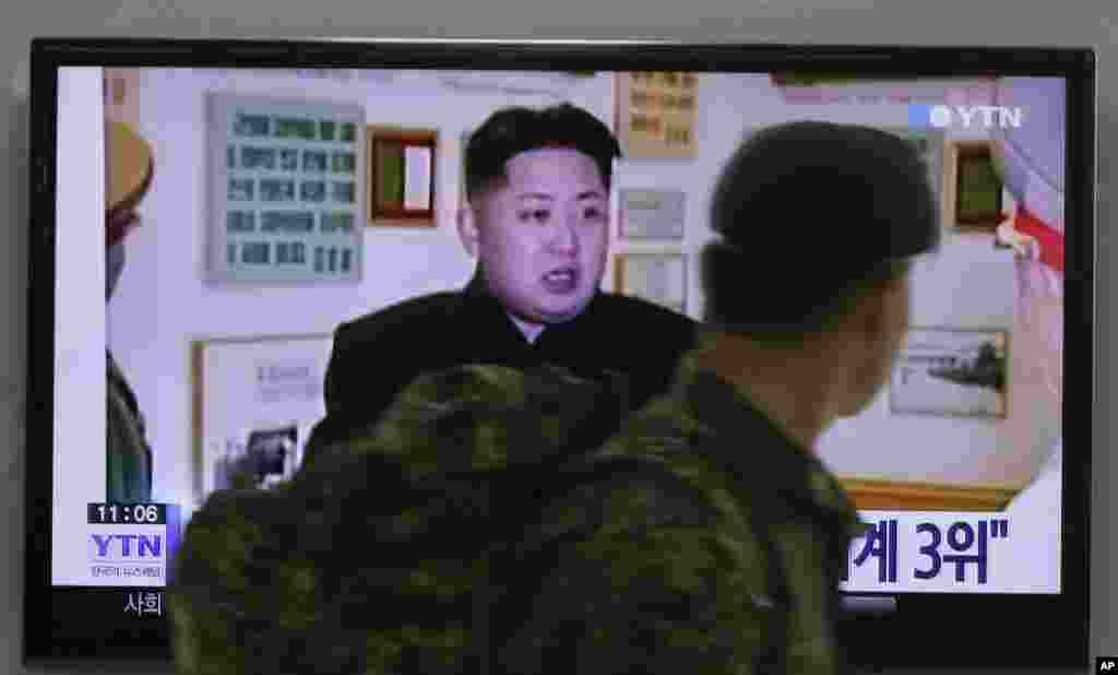 A South Korean army soldier watches a TV news program showing North Korean leader Kim Jong Un, at the Seoul Railway Station in Seoul, South Korea, Dec. 22, 2014.