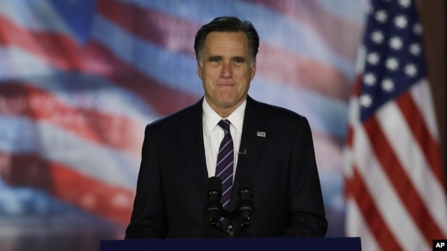 Republican presidential candidate and former Massachusetts Gov. Mitt Romney arrives at his election night rally in Boston, early Wednesday, Nov. 7, 2012.
