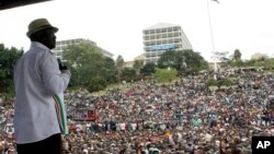 Orange Democratic Movement leader Raila Odinga addresses the crowd during a rally at Uhuru Park in Nairobi, July 7, 2014.