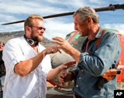 Co-writer/director Joe Carnahan reviews a scene with Liam Neeson on the set of The A-Team