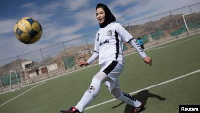 2e45e6201 FILE - A female soccer player controls a ball during a training session at  the Golab