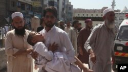 FILE - Family members rush a boy to a hospital after receiving a polio vaccination, in Peshawar, Pakistan, April 22, 2019.