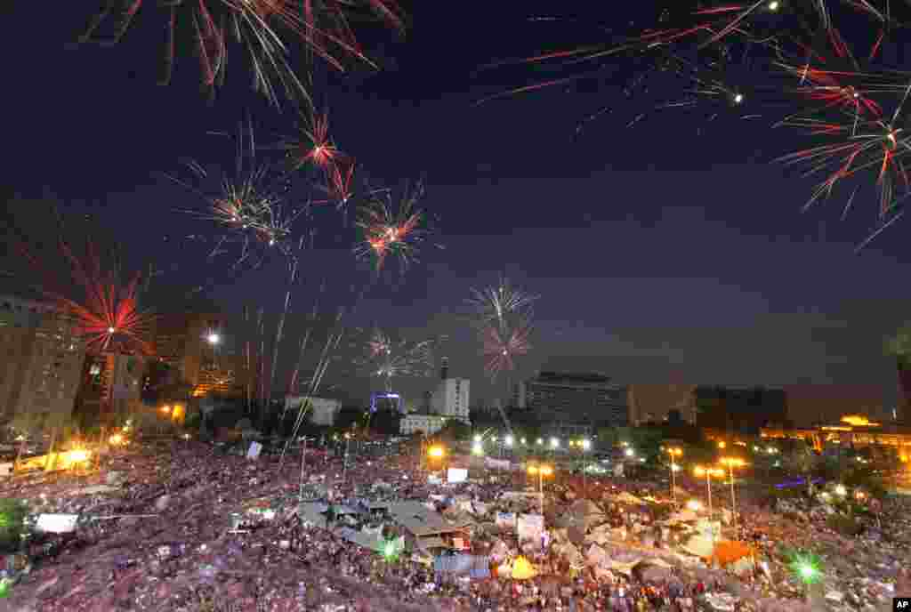 Fireworks burst over opponents of Egypt's Islamist President Mohammed Morsi in Tahrir Square in Cairo, July 2, 2013.