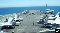 A view of the crowded flight deck of the carrier