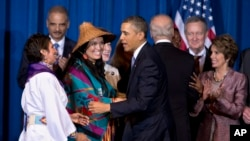 FILE - President Barack Obama greets Our Sisterís Keeper Executive Director Diane Millich, from left, and Tulalip Tribes of Washington State Vice Chairwoman Deborah Parker, after signing the Violence Against Women Act in Washington, D.C., March 7, 2013. Five years after a federal law gave tribes authority over non-Natives for some domestic violence crimes, public safety advocates say communities are empowered to report wrongdoing and governments are working better together.