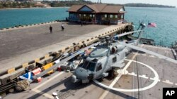 A helicopter parks on a USS Gary warship docked at Sihanoukville port some 185 kilometers (115 miles) southwest of capital Phnom Penh, file photo.
