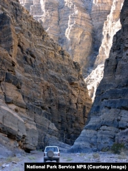 The narrows of Titus Canyon can be explored either by vehicle or on foot
