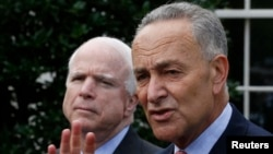 U.S. Senators Charles Schumer (D-NY), right, and John McCain (R-AZ), address media after White House immigration meetings, July 11, 2013.