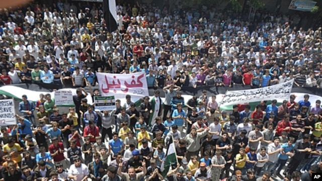 Demonstrators protest against Syria's President Bashar Al-Assad in Kafranbel, near Idlib, April 27, 2012.