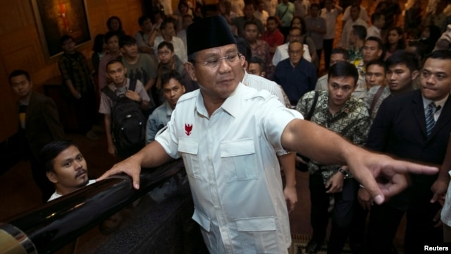 Indonesian presidential candidate Prabowo Subianto gestures after a meeting with members of his coalition in a hotel in Jakarta, July 20, 2014.