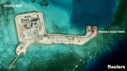 FILE - A satellite image released by the Asian Maritime Transparency Initiative at Washington's Center for Strategic and International Studies shows construction of possible radar tower facilities in the Spratly Islands in the disputed South China Sea.