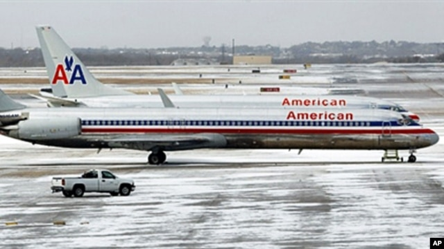 American Airlines jets sit idle after an overnight ice storm forced the closure of DFW International Airport in Dallas, Texas, February 1, 2011