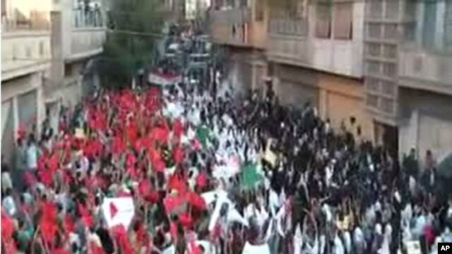 An image grab from footage uploaded on YouTube made available on September 18, 2011, shows a protest by Syrian students on the first day of school in the flashpoint city of Homs.