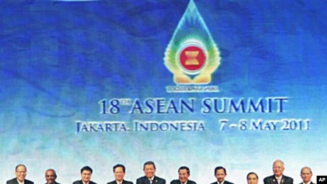 Heads of states and governments of the Association of Southeast Asia Nations pose for a group shot during the opening ceremony of the 18th ASEAN Summit in Jakarta, Indonesia, May 7, 2011