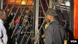 Police locked the entrances and exits at Club Venom Thursday night. Revelers were forced to sit on the floor and had their cameras and phones confiscated. Kampala, Uganda, Aug. 4, 2016. (L. Paulat/VOA)
