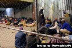 Tobacco farmers prepare to sleep at the auction floors in Harare, Wednesday, April 14, 2021.