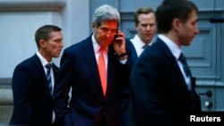 U.S. Secretary of State John Kerry makes a phonecall after a meeting in Vienna, Nov. 21, 2014.
