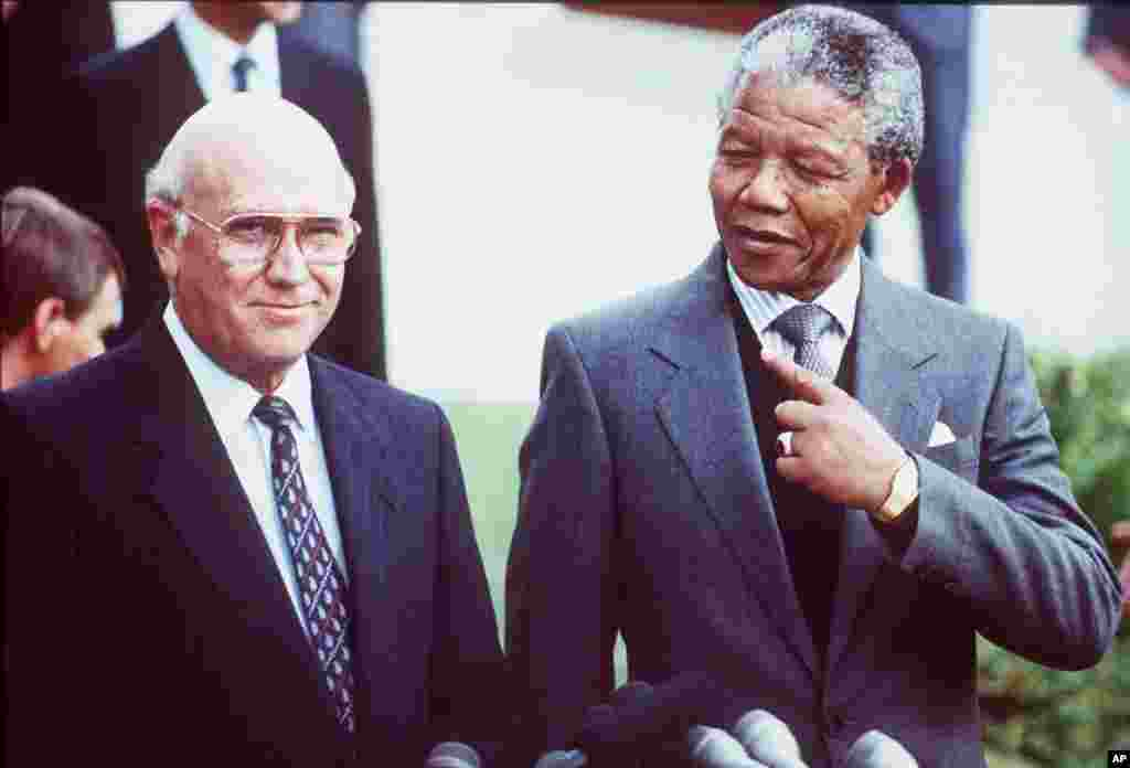 South African State President Frederik Willem de Klerk and Deputy President of the African National Congress Nelson Mandela prior to talks, Cape Town, May 2, 1990.