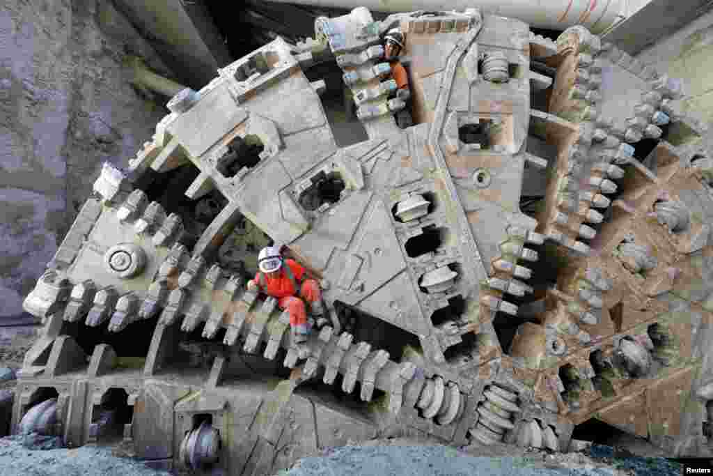 Workers climb out from a tunnel-boring machine (TBM) during the breakthrough of a tunnel for the future tramway line in Nice, France.