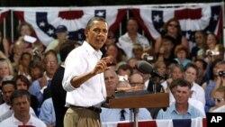 奥巴马总统8月15日在明尼苏达州坎农瀑布镇的市政会议上讲话
