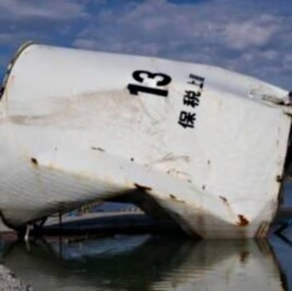 Fuel tank transported by the tsunami in Onagawa, Japan.