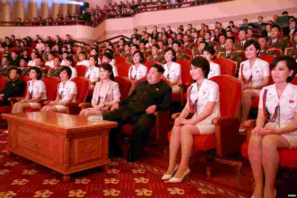 North Korean leader Kim Jong Un (3rd R) and wife Ri Sol Ju (4th L) enjoy an art performance given by the Chongbong Band to mark the 70th anniversary of the founding of the Workers' Party of Korea (WPK) in this undated photo released by North Korea's Korea Central News Agency (KCNA) in Pyongyang.