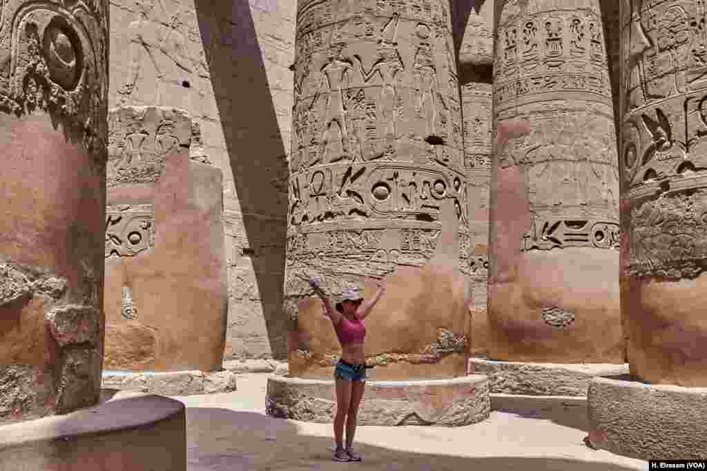 On World Heritage Day a tourist poses for a photograph in Karnak temple in Luxor, Egypt, April 20, 2018.