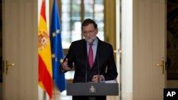 El presidente del gobierno español, Mariano Rajoy, habla durante una conferencia de prensa en el palacio de la Moncloa, en Madrid, el 29 de diciembre.
