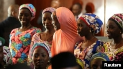 FILE - Some of the 21 Chibok girls released by Boko Haram look on during their visit to meet President Muhammadu Buhari In Abuja, Nigeria, Oct. 19, 2016.